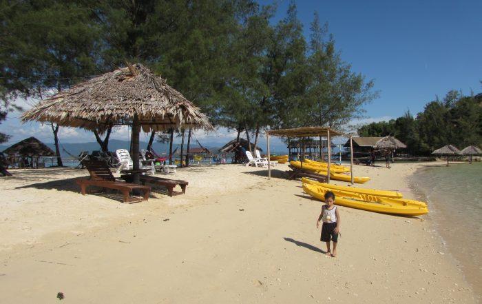 Fluffy sandy beach around Dinawan Lagoon
