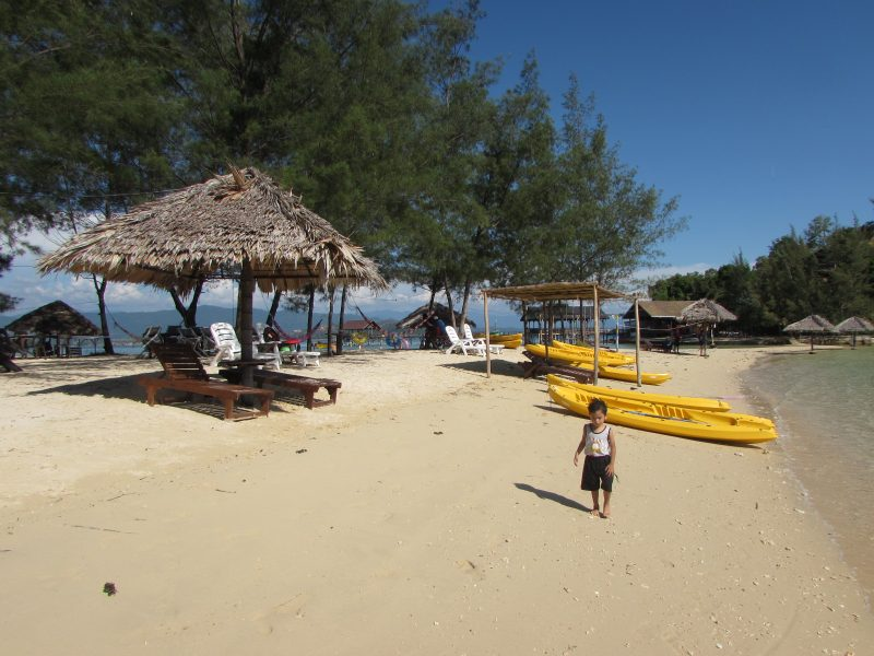 Fluffy sandy beach around Dinawan Lagoon