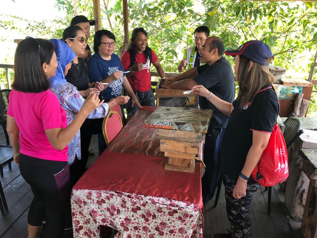 Educating visitors about stingless bee at Borneo Eco-House
